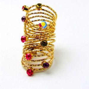 Gold slinky rhinestone ring iridescent and sparkly